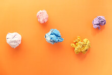 Top View Of Crumpled Paper Balls On Orange Background