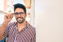 Young Handsome Hispanic Man With Beard Wearing Glasses Smiling Happy Outdoors