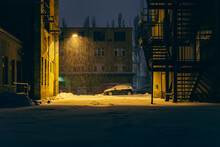 A Parking Lot In An Industrial Setting In The Evening And When It Is Snowing, Street Lights, Snowfall, Parking Lot