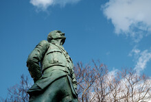 Jan Smuts Statue Against A Tree And Blue Sky