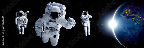 Tablou Canvas Astronaut spaceman do spacewalk while working for space station in outer space