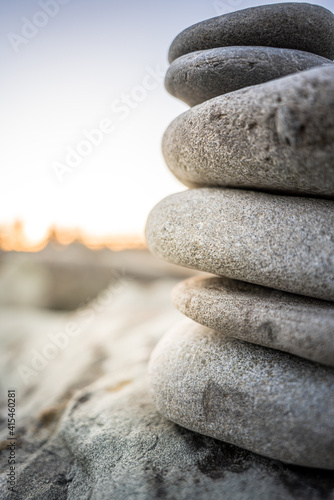 Canvas Print Stones in front of a sunset