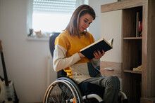 Disabled Woman Reading A Book At Home