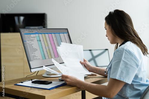 Fototapeta Medical Bill Codes And Spreadsheet Data obraz