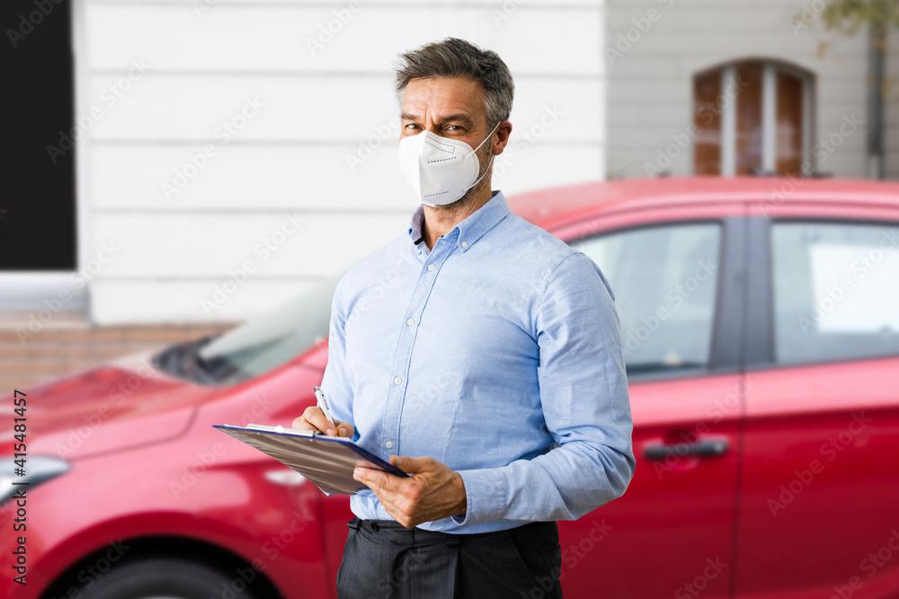 Fototapeta Salesman In Car Salon