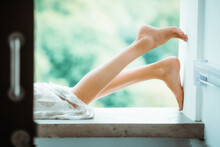 Woman's Legs Up Closeup Laying Down On Balcony. Lush Green Light Background. Beautiful Relax, Spa Concept