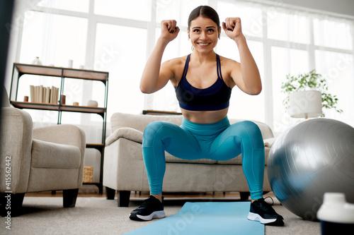 Fototapeta Slim woman doing exercise, online pilates training obraz