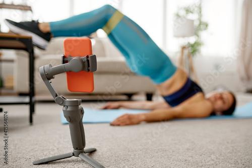 Fototapeta Girl doing stretching exercise, online training obraz