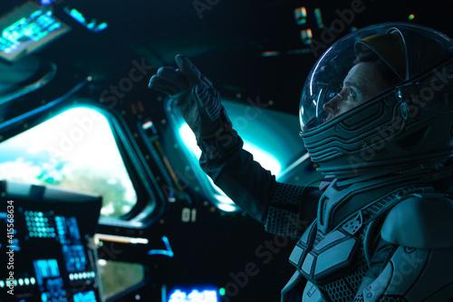 Portrait of Caucasian male astronaut inside spaceship cockpit Fotobehang