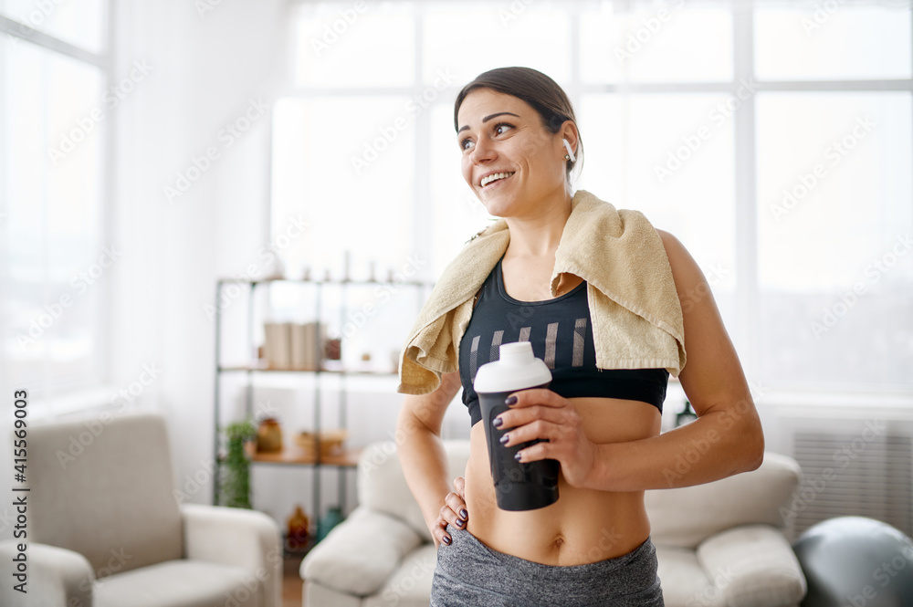 Fototapeta Woman holds mat, online fitness training