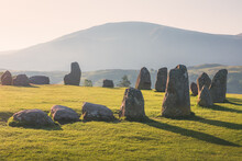 Golden Sunrise Or Sunset Light Cast Across The Historic And Sacred Megalithic Site Castlerigg Stone Circle Near Keswik, In The Lake District, Cumbria, England.