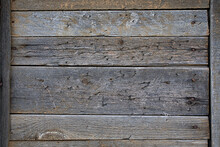 A Wooden Wall Made Of Planks With Peeling Green Paint. Background