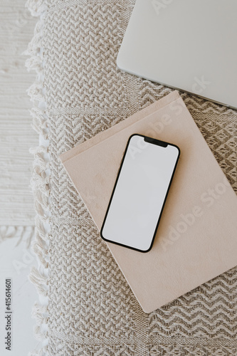 Flat lay of cellphone on blanket plaid with notebooks. Blank copy space mockup template screen display. Flatlay, top view social media, web, blog, app concept. - fototapety na wymiar