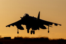 RAF Harrier GR9 Strike Fighter Landing Silhouette At Sunset With An Orange Sky