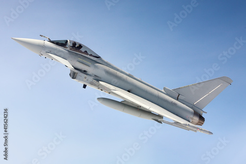 RAF (Royal Air Force) Typhoon Fighter Jet air to air photograph against a blue s Fototapeta