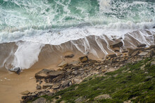 High Angle Shot Of Foam Waves Washing The Shore