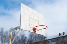 An Old Basketball Backboard Without A Hoop Net. Sports Ground In The Yard