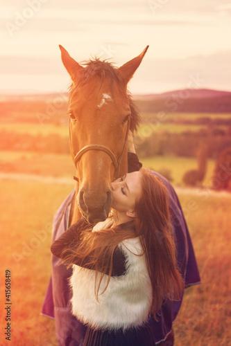 Fototapeta woman with horse sunset love cute obraz