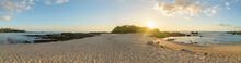 Sun Setting On Two Beaches