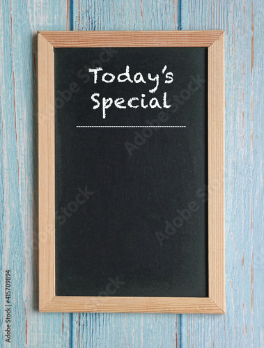 Fotografie, Obraz Today's Specials - words in white chalk on a blackboard isolated on blue wood