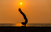 Sport Woman Yogini Pose Practice Yoga Exercise On Sand Beach Near Coconut Palms In Relaxing Day , Yoga Is Meditation And Healthy Sport Concept
