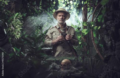 Fotografija Explorer with binoculars in the jungle