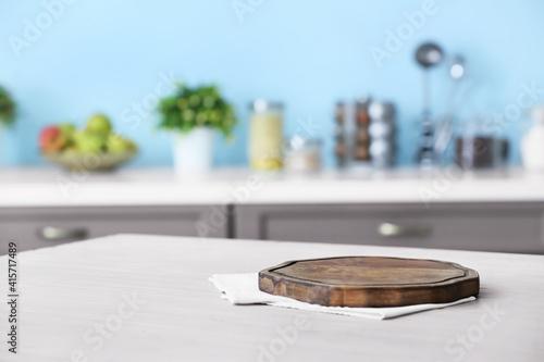 Fototapeta Wooden board on table in modern kitchen obraz