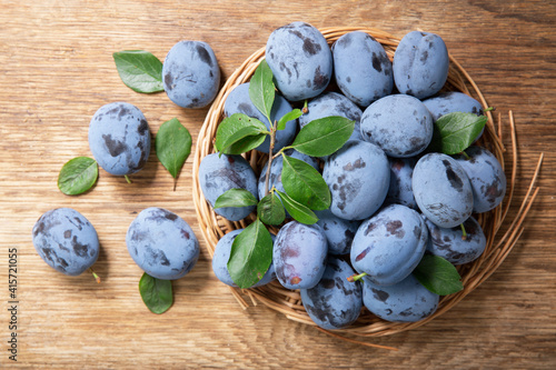 fresh ripe plums with leaves, top view © Nitr