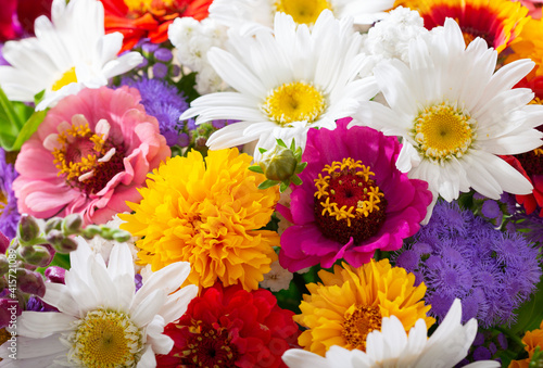 bouquet of summer flowers as background, top view © Nitr
