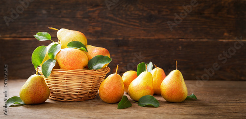 fresh ripe pears with leaves in a basket © Nitr