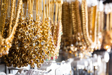View Of Assorted Golden Necklaces On Showcase In Bijouterie Shop