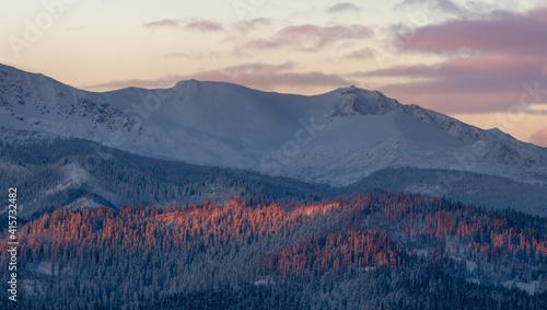 Beautiful mountain landscape, snowy mountain summits during romantic winter sunrise - Tatra Mountains, Poland © Mike Mareen