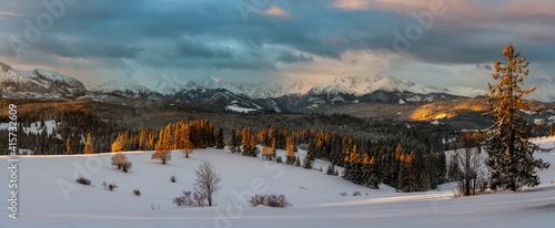 beautiful winter mountain landscape during dramatic sunrise © Mike Mareen