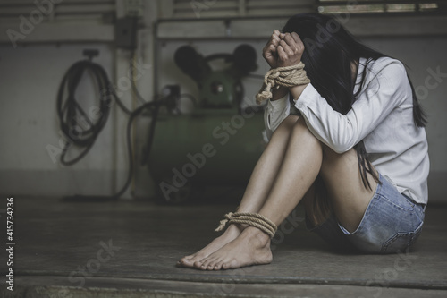 hopeless man hands tied together with rope, human trafficking, Stop abusing violence Fotobehang