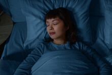 People, Relax And Comfort Concept - Young Asian Woman Sleeping In Bed At Home At Night