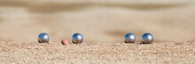 Metallic Petanque Four Balls And A Small Wood Jack