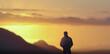man hiker on top peak mist mountains at morning sunrise.