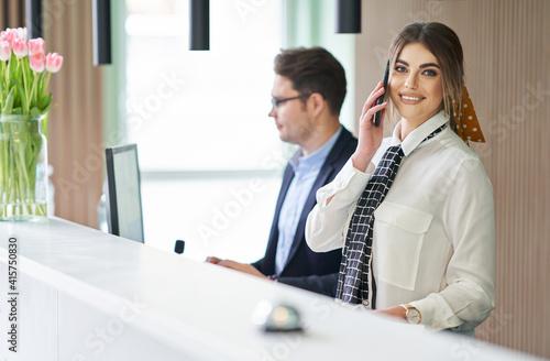 Vászonkép Receptionist working in a hotel