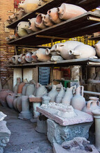 Excavated Roman Amphorae, Pottery And Other On Display In The Former Forum Granary At Pompeii, Italy. The Artifacts Buried Under Ashes After Eruption Of Vesuvius. Soft Selective Focus, Long Exposure