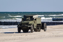 HALF TRACK TRANSPORTER - A Historic Military Vehicle Of The 1st Polish Army On A Sea Beach