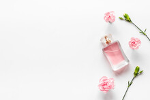 Top View Of Perfume Bottle And Flowers. Flat Lay