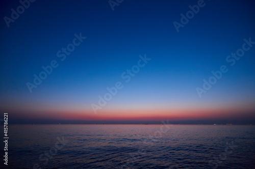 Fényképezés 鮮やかで綺麗な海の夕焼けの風景