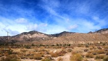 Driving Through The Mojave Desert Landscape While Watching The Scenery Out The Passenger Window