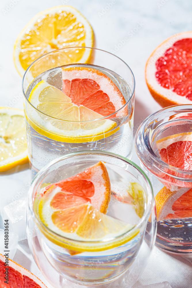 Fototapeta Water with grapefruit and lemon. Fresh citrus sassi water.
