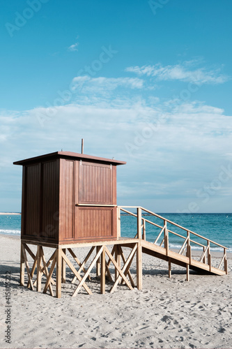 Fototapeta lifeguard tower in a lonely beach. obraz