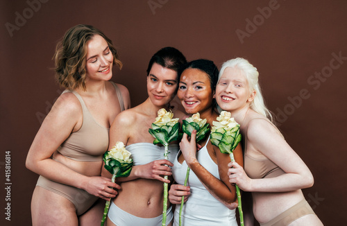 Fototapeta Group of multiethnic women with different kind of skin posing together in studio. Concept about body positivity and self acceptance obraz