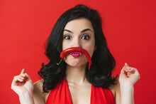 Image Of Beautiful Woman Having Fun With A Red Chili Pepper