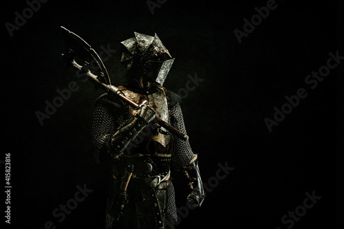 Papel de parede Portrait of a medieval fighter in armor, in profile, an ax on his shoulder