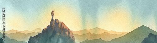 Fotografija scalatore sulla vetta di una montagna