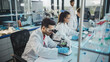 canvas print picture Medical Science Laboratory: Row of Diverse Team of Multi-Ethnic Young Scientists Looking Under Microscope, Analyze Chemicals, Talk, Solving Problems. Biotechnology Specialists working in Advanced Lab